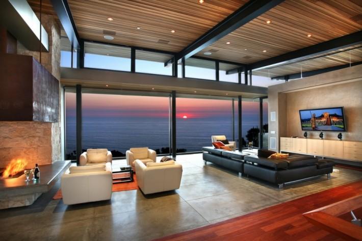 Nowoczesna architektura nowoczesny apartament z widokiem na morze z kominkiem i częścią te ZR87