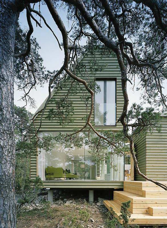 Zielona eelewacja domu letniego, drewno